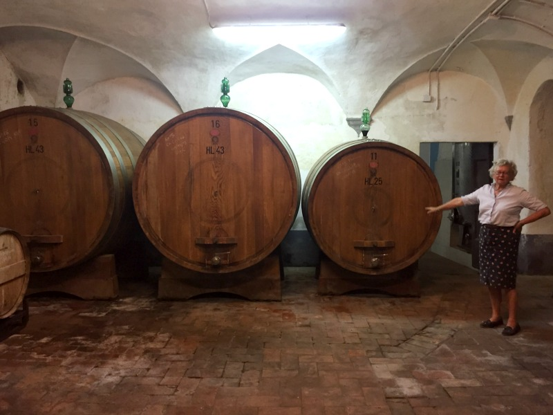 Anna in the wine cellar | Slow Travel in Tuscany with Km Zero Tours | BrowsingItaly.com